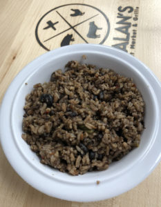 Galan's congri is a traditional Cuban side dish of rice and black beans with tiny veggie dice.