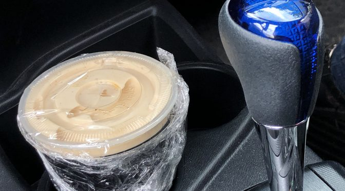 Irish Rover's bar staff seals up a full pint of Guinness safely with plastic wrap and a tight lid. And it fits in my cup holder! (Leave it sealed until you get home, though!)