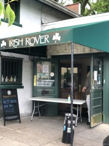 A long table at the entrance to the Irish Rover makes it easy to pick up your dinner with proper no-touch social distancing. pickup.