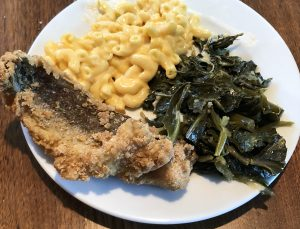 Plated to enjoy at home, LuCretia's boneless whiting fillets are fried crisp, flaky, and perfectly cooked. They were served with excellent greens, macaroni and cheese, and a block of cornbread.