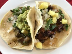 MexA's Norteño taco with beef and guacamole and a pork pastor and cheese taco with pineapple make a filling plate.