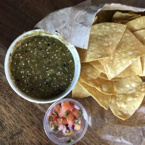 Crisp yellow-corn chips and fiery green tomatillo-jalapeño salsa from El Mundo Highlands.Crisp yellow-corn chips and fiery green tomatillo-jalapeño salsa from El Mundo Highlands.