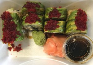 The dragon roll at ToGo Sushi places eel and cucumber within a roll topped with avocado and tobiko, flying fish roe.