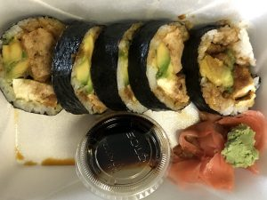 The tofu roll at ToGo Sushi is oversize, filled with fried silken tofu and avocado with its nori seaweed wrapper on the outside.