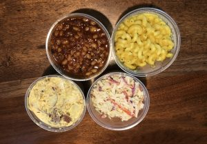 Four tasty vegan side dishes at Morels: Clockwise from upper right, smoked baked beans, mac & cheese, coleslaw, and loaded potato salad.