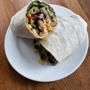 Taco Choza's hulking Burrito Vegetariano is loaded with a healthy collection of tasty veggies along with Mexican rice and two kinds of beans.