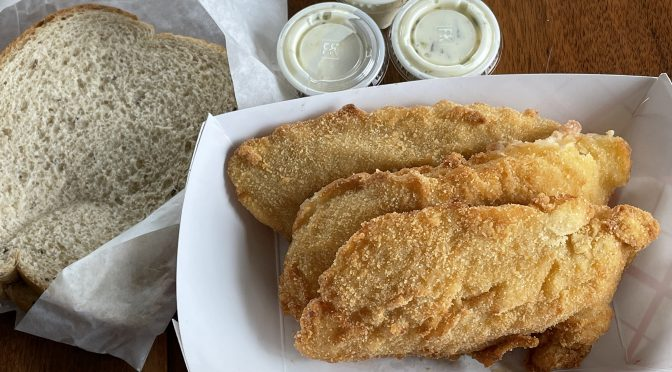 The Fishery's fried Icelandic cod platter features a generous portion of three fillets and two sides.