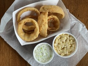 Thick-cut, thickly breaded onion rings, fresh cole slaw and simple, creamy mac-and-cheese are popular side dishes at the Fishery.