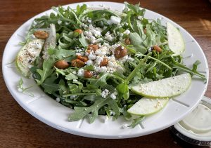 Hog Father's arugula salad is a real winner, thoughtfully imagined and carefully prepared.