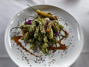 Blistered shishito peppers are a frequent appetizer special at Seviche. When you're on the menu, you'll want to try these mild, subtly flavored grilled peppers with their soy-lime glaze.