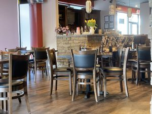 Jasmine's tables appear closely spaced, but staff set diners apart
