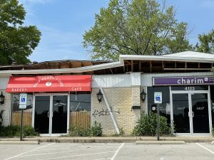 The roof that collapsed almost two years ago and forced four popular restaurants to close remains upended into the space once occupied by Half Peach and Charim.