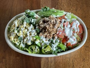 """The raw taco salad at Half Peach is healthy as can be, topped with vegan taco """"meat"""" fashioned from nuts and seeds."""