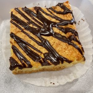 Chess pie, known for its sweet simplicity, makes an excellent chocolate-drizzled bar.