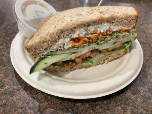 The memorable Mid City Underground sandwich is a tantalizing mix of crunchy, soft, and chewy veggies, Jarlsberg cheese, scallion cream cheese, and lemon-dill mayo on thick wheat bread.