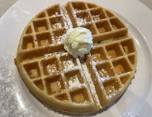 Thick, crisp, and fresh from the griddle, with maple syrup and butter, Wild Eggs' Belgian waffle is a delight.