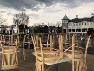At the end of March 2020, with the pandemic lockdown in full force, chairs stood on tables within Wild Eggs' locked doors; its windows reflected an empty Westport Village parking lot.
