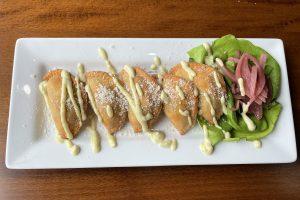 Veggie empanadas at Faces make a great starter with their deep-fried, umami-rich goodness.