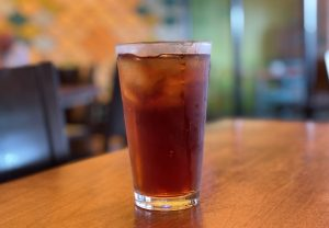 Iced tea was fresh, cold and strong, served in a tall glass.