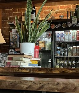 Nothing signals Pints & Union's hospitality more than a random stack of books handy for you to pick up and read if you'd rather enjoy your drink quietly alone.