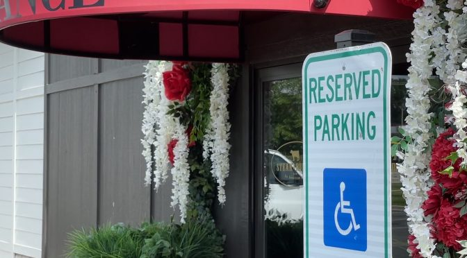 Steak & Bourbon in Westport Village demonstrates easy access, with reserved parking spaces for disabled drivers located adjacent to the accessible main entrance.