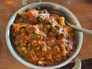 A produce shop full of veggies swim in thick, fiery gravy in vegetable Igguru, a curry with roots in Andhra on the Bay of Bengal.