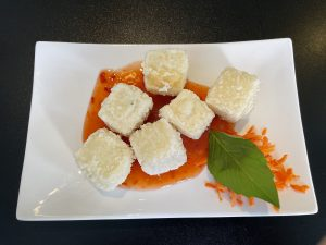 How do they keep deep-fried cubes of shattering crisp tofu so pure white? The server wouldn't give up the secret.