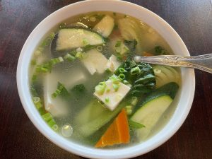 Veggie tofu soup was a triumph of simplicity, aromatic and clear, built on a broth that signals a skilled chef at work.