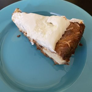 A generous slice of coconut pie was creamy and rich, with a dollop of whipped cream to top it off.