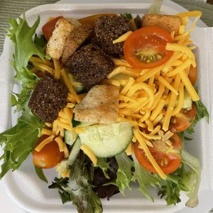 Starving Artist's tossed salad is fresh and delicious, with three kinds of croutons as a tasty bonus.