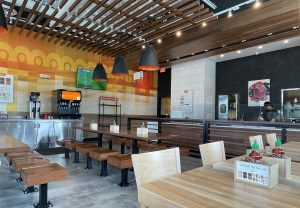 Currito's spacious, high-ceilinged room is bright in abstract orange, yellow, red and white, with spare, shiny wood seats and tables, and sports on flat screens around the room.