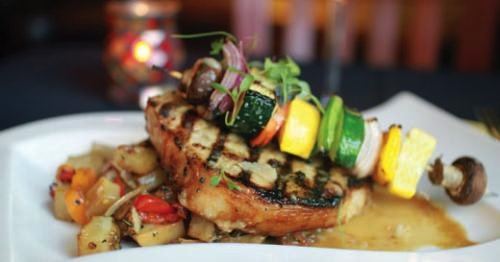 Grilled pork chop at Brix. LEO photo by Ron Jasin.