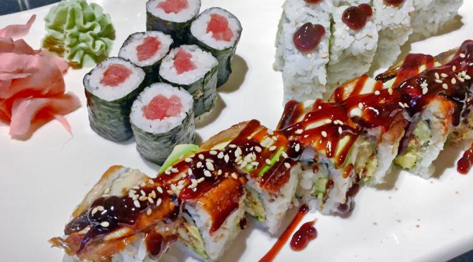 A sushi plate at Asahi: Dragon roll, tuna roll and AAC roll.
