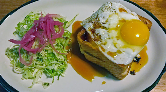 Grilled cheese sandwich topped with a fried egg at Portage House.