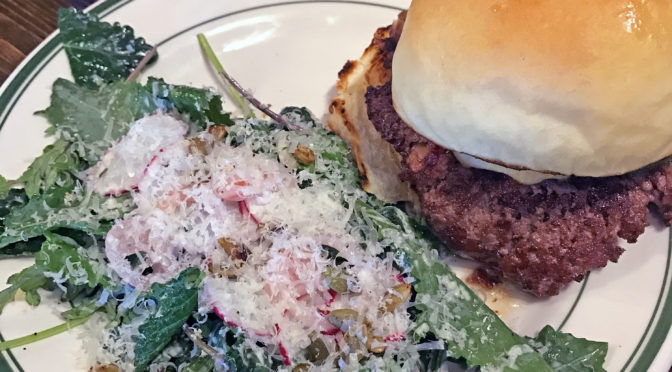 """The Southern burger with a side of """"What the Kale"""" salad at Grind."""